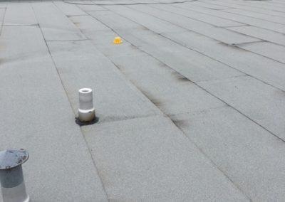 Installation de toiture membrane élastomère pour toit plat à Laval - Toitures Duvernay de Laval